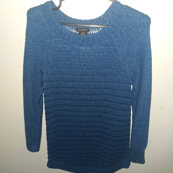 Long knitted blue sweater
